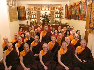 Lama Dondrup Dorje with students at the Palyul Tibetan Buddhist Meditation Centre in Newcastle upon Tyne